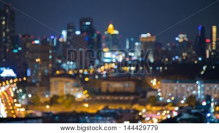 Night view, blurred bokeh lights city downtown at twilight