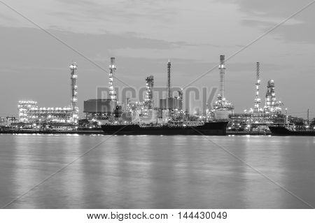 Black and White, Oil refinery riverside with sunrise sky background