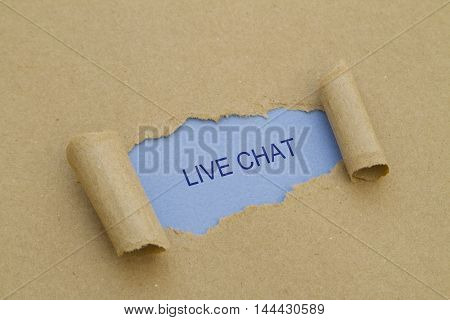 LIVE CHAT word written under torn paper .