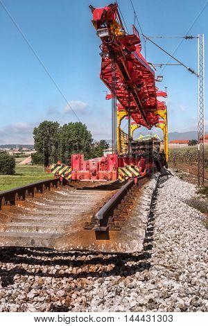 Heavy machinery repairs rail lines