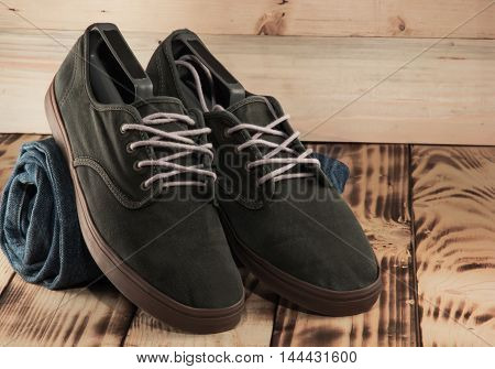 Fashion Dark Green Sneakers And Jeans Clsoeup