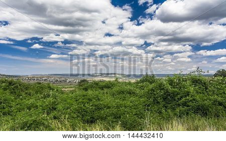 Mountain valley with a cloudy sky. Natural summer landscape. Stock photo