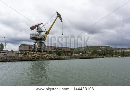 Rusty port crane. Cargo port in the Crimea. Stock photo