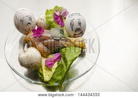 Two eggs weeping at chicken's funeral. Raw food