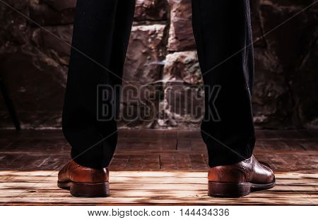 Standing Leg On The Balck Classikal Trousers And Brown Oxfords