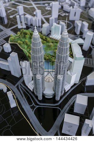KUALA LUMPUR MALAYSIA - AUGUST 10 2016: Scale model of a city showing the Petronas Twin Towers. Petronas Twin Towers also known as KLCC (Kuala Lumpur City Center).