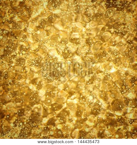 Gold Festive Christmas background. Elegant abstract background with bokeh defocused lights