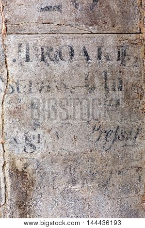 wall background texture with fragments of antique writings