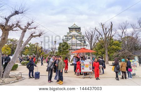 Osaka, Japan - March 11, 2016: Osaka Castle on March 11, 2016. Tourists are taking photo in the park in front of Osaka Castle.
