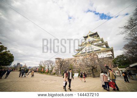 Osaka, Japan - March 11, 2016: Osaka On March 11, 2016. Tourists are walking around the park in Osaka castle.