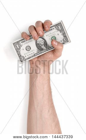 Close-up view of a man's hand holding one-dollar banknotes, isolated on white background. Money and wealth. Finance and business. Loans and debts.