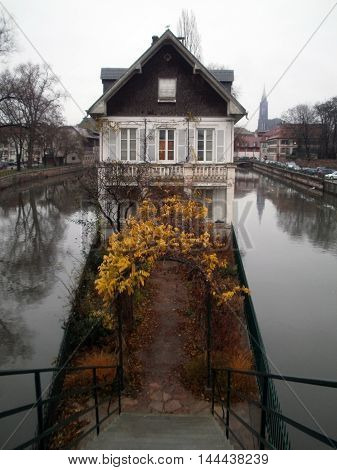 A beautiful ancient house on a river in Strasbourg