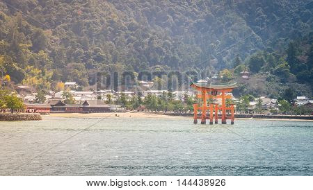 Miyajima island red Torii with mountain in background