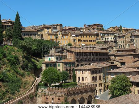 View of the old city centre in Siena Italy with the Fonte Branda