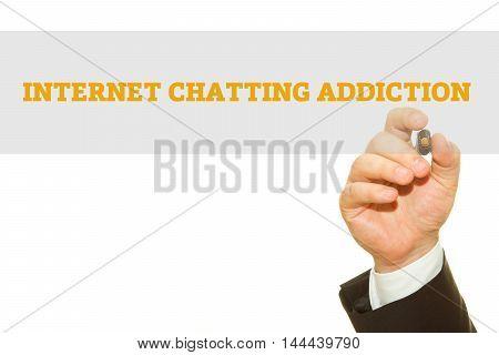 Businessman hand writing Internet Chatting Addiction isolated on white.