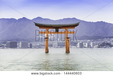 Hiroshima, Japan - March 16, 2016: Miyajima on March 16, 2016. Miyajima Torii is floating on water.
