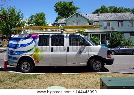 PETOSKEY, MICHIGAN / UNITED STATES - AUGUST 5, 2016: A white AT&T van is parked near downtown Petoskey.