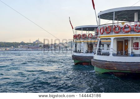Istanbul Ferry in Karakoy pier. Hagia Sophia museum in the background appears. Istanbul Ferries continue to serve as a key public transport link for many Thousands of commuters tourists and vehicles per day.