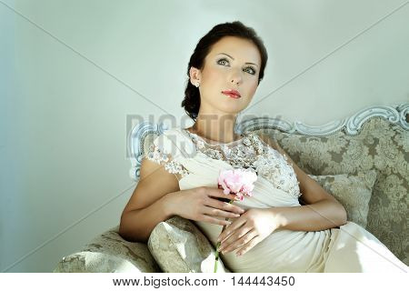 Elegant woman in evening gown with a flower