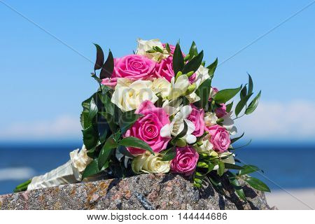 wedding bouquet the bride on background of sea and sky