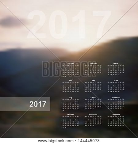 Vector calendar template. 2017 year. Blurred nature background. Week starts on Monday. Vector calendar template 2017, calendar page, wall calendar poster. Nature mountains vector background.