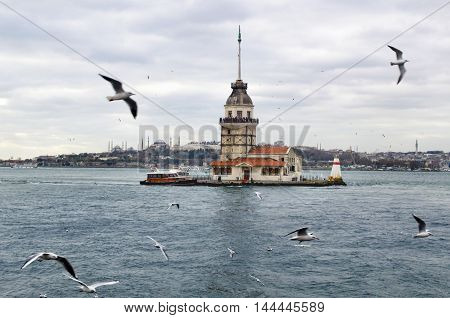 European part of Istanbul in the background against the shore. Left Blue Mosque medium Hagia Sophia Topkapi palace dome seem right. The Maiden's Tower (Turkish: Kiz Kulesi) also known as Leander's Tower since the medieval Byzantine period is a tower lying