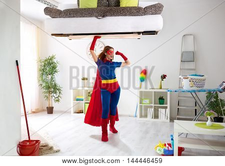 Sexy Strong Super Hero Woman Holding Bad In The Air
