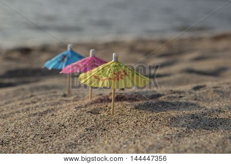 UMBRELLAS COLOR ON THE BEACH ON THE SEASHORE
