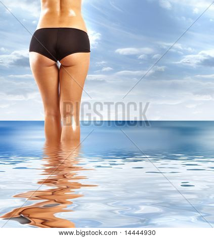 Back and ass of beautiful woman over abstract background