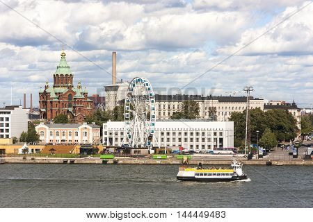 Cityscape of Helsinki capital of Finland with a church and ferris wheel