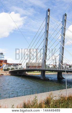 Tall white suspension bridge over a river