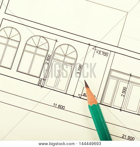 architecture blueprint of house and pencil, square toned image