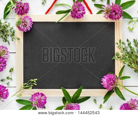Empty Blackboard, Floral Border From Flowers And Herbs. Top View, Flat Lay.