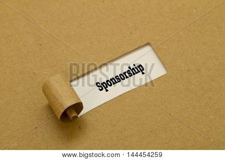 Sponsorship word written under torn paper .