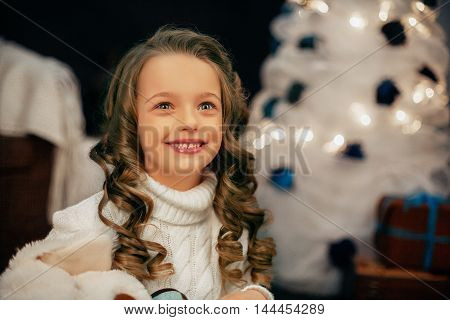 a beautiful little girl. The concept of the New Year and Merry Christmas