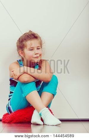 Happy Joyful Little Girl Kid Sitting On Pillow.