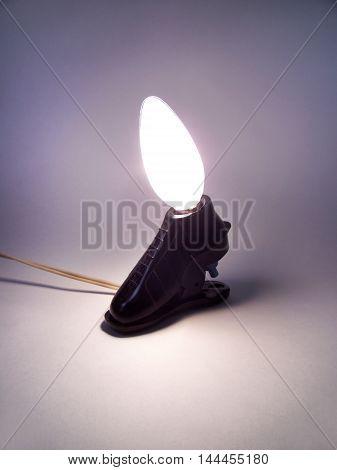 Table lamp unusual elegant shape. Incandescent lamp