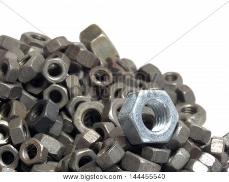 a jumble from the old hex nuts and new silver one on the heap. On white back