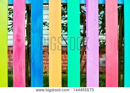 Wooden fence from colorfu lplanks