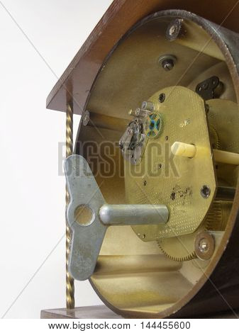 Clock with key winding and open the back cover. View on mechanism
