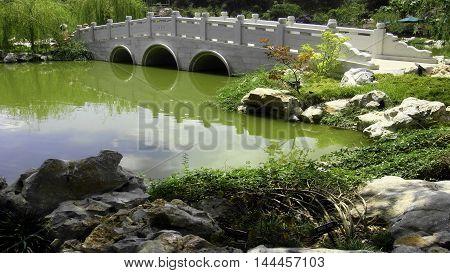 A Water Bridge At A Chinese Garden