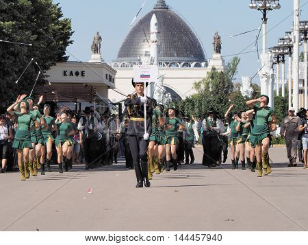 MOSCOW, RUSSIA - August 27, 2016: Girls of Slovenia brass band throw up drum majors. Festival of military orchestras