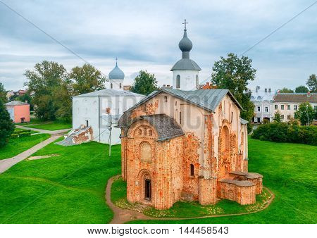 Summer birds eye view of Yaroslav Courtyard churches - Assumption Church and Paraskeva Pyatnitsa Church. Veliky Novgorod Russia. Architecture landscape in cloudy weather