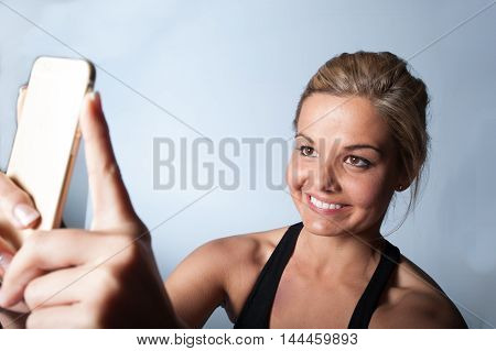 Girl At The Gym Checking Her Phone