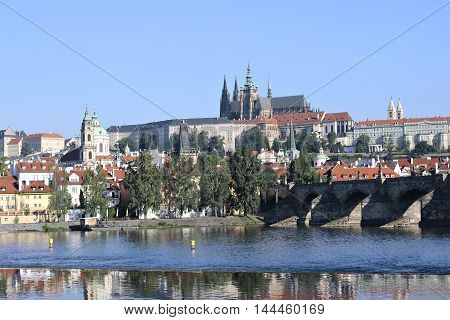 PRAGUE, CZECH REPUBLIC - JUNE 24, 2016: Prague Castle and Charles Bridge over the Vltava River in Prague against a blue sky