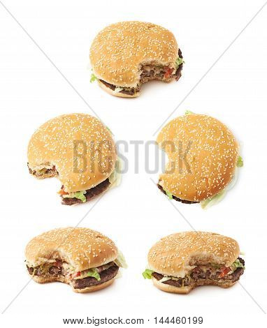 Fresh cooked hamburger with a single bite taken, composition isolated over the white background, set of five different foreshortenings