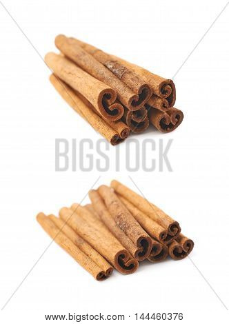 Pile of multiple cinnamon sticks isolated over the white background, set of two different foreshortenings