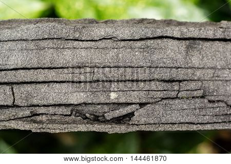 Cracks in weathered tombstone. Gravestone showing fissures due to weathering where water entering and freezing stresses and breaks the stone along weaknesses