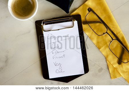 A shopping list with coffee and spectacles.