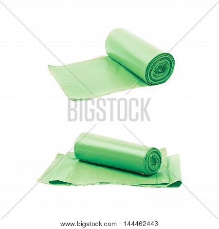 Green plastic polyethylene trash bag roll isolated over the white background, set of two different foreshortenings